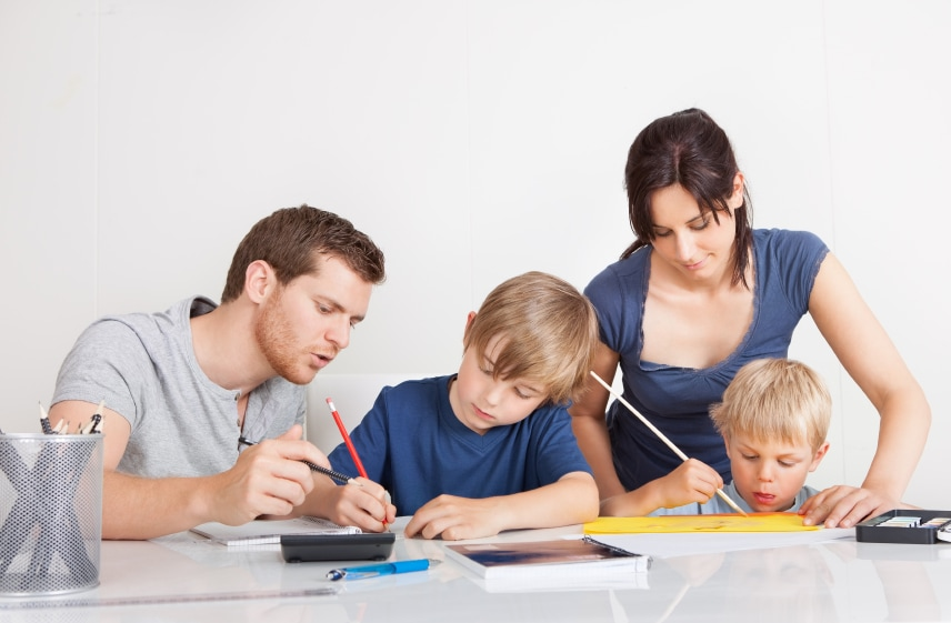Young family doing homework together at home